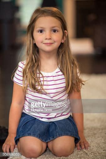 little girls little pics little girl kneeling on the carpet stock photo getty images