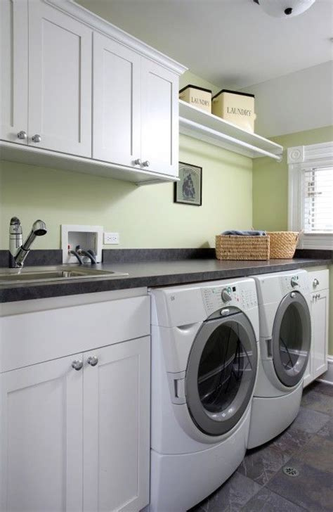 Laundry Room Cabinets With Hanging Rod I Like The Hanging Clothes Rod Combined With Storage Above Laundry Room Cabinets With Clothes