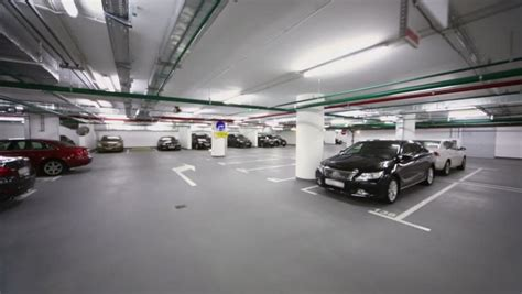 underground parking many cars stand in underground parking with piping and