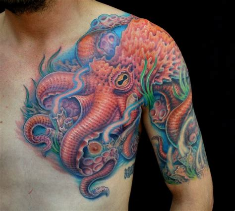 left chest tattoo colored octopus on chest and left shoulder