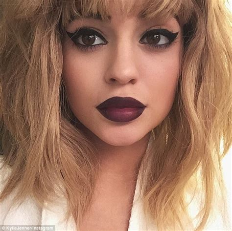 blonde hair purple lipstick kylie jenner puts on blonde wig and purple lipstick for