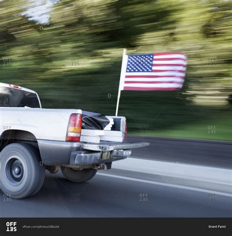 flag truck speeding truck with flag stock photo offset