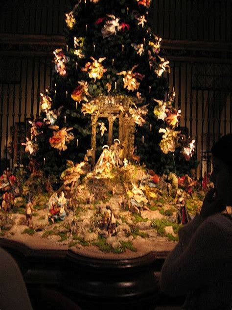 the tree has hundreds of angels descending upon baby jesus