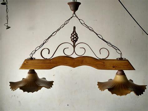 ladari in ferro battuto rustici ladario bilanciere rustico in ferro battuto legno