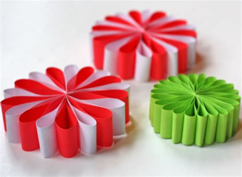 christmas decoration useing construction paper craft of the day paper flower ornaments huffpost