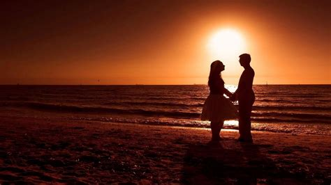 wallpaper sunset couple romantic couple on beach during sunset hd desktop