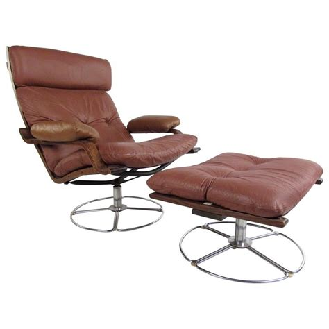 swivel chair with footstool vintage leather westnofa style swivel lounge chair with ottoman at 1stdibs