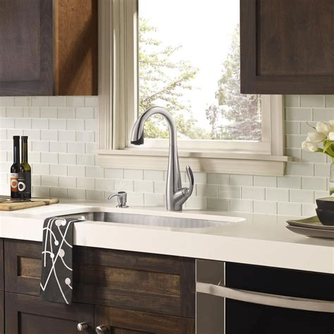 white kitchen cabinets with glass tile backsplash white glass tile backsplash white countertop with dark