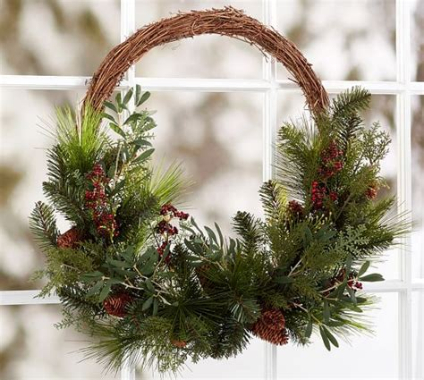 oversized asymmetrical pine and berry wreath pottery barn