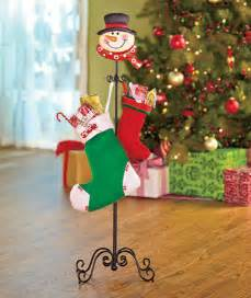 new standing snowman or santa stocking holder stand