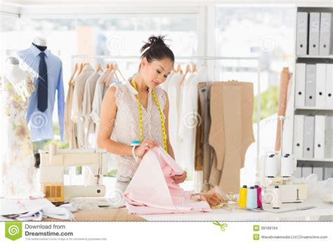 concentrated fashion designer at work stock photo