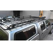 D40 Nissan Navara With ARB Canopy And 2800mm Long Oval Steel Roof Rack