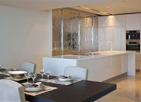 white kitchen island silver feature wall interior design