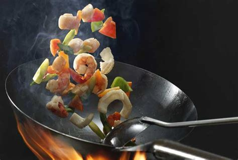 best wok for stir fry how to use a wok for stir frying steaming foodal