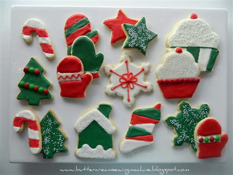 buttercream and a sewing machine decorating christmas cookies