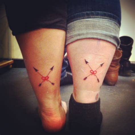 friendship tattoo crossing arrows and red string of fate
