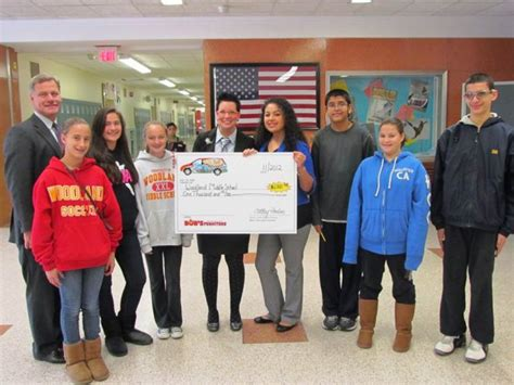 east meadow upholstery woodland receives 1 000 donation from bob s furniture