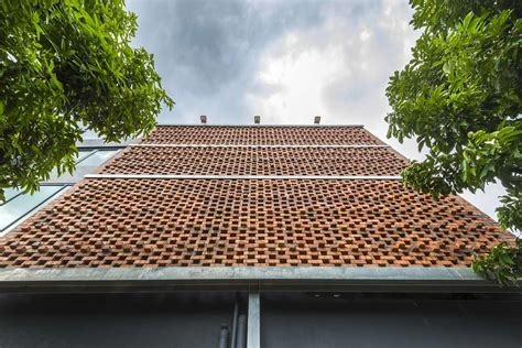 Perforated screens made from reused terracotta roof tiles