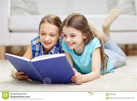 Reading Friends by Two Happy Reading Book At Home Stock Photo Image