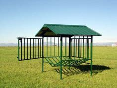 no waste round bale feeder assembled with roof: i like