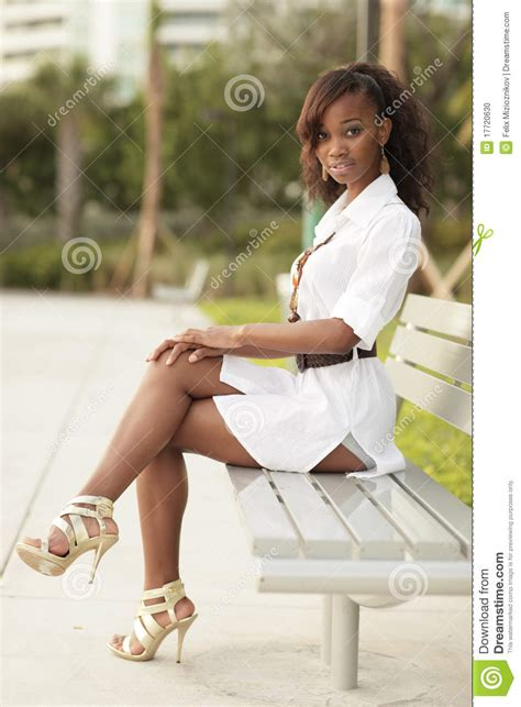 woman on bench woman sitting on the bench stock photo image 17720630
