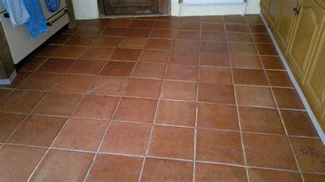 restoration of terracotta floor in a kitchen area