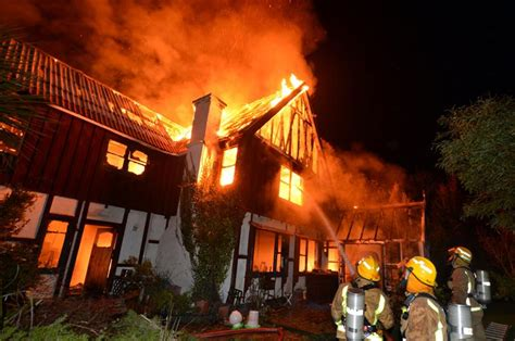 woman jumps  burning home otago daily times  news