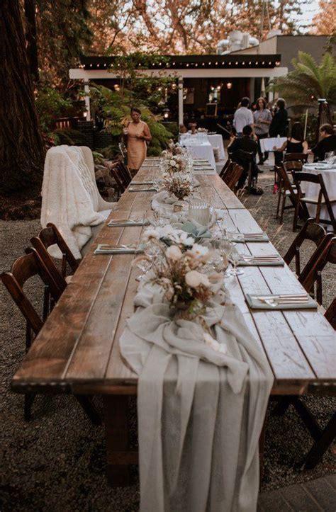 Boho wedding reception decor idea   long, wooden tables