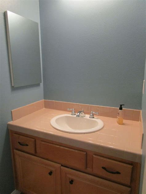 updating a small bathroom on a budget kids guest bathroom update from builder basic to wow on