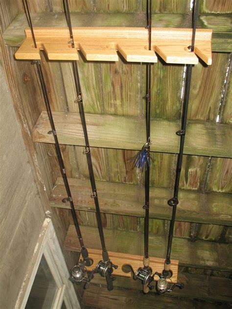 best 25 fishing rod rack ideas on fishing