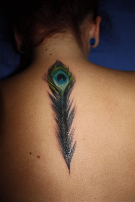 peacock back tattoo peacock feather by bogiak on deviantart