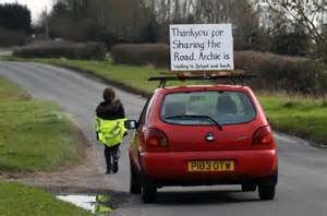 You Own A Car Not The Road Yellow anxious drives his as he walks to school