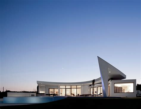 contemporary style architecture curved wall architecture framing outstanding views