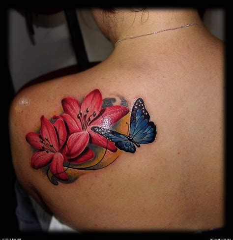 raw ink tattoo realistic lilies with butterfly artists org