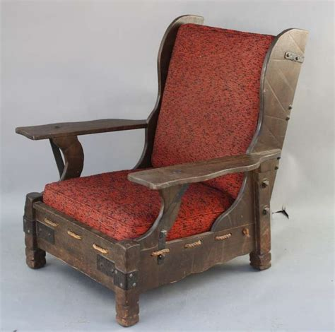 monterey wood finish wingback chair with rope bottom