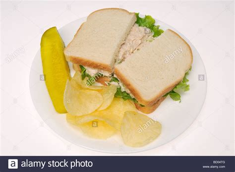 Tuna Mayo Pyramid Bread tuna mayo sandwich on white bread with potato chips and pickle on stock photo royalty free