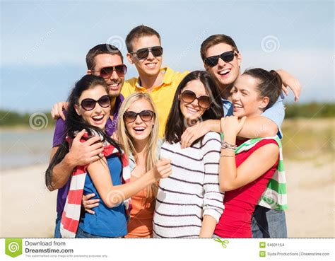 sonofka vacation group of friends having fun on the beach stock images