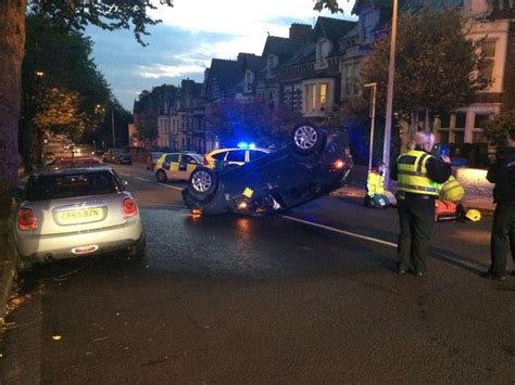 car crash south wales cut out of overturned car and taken to hospital after cardiff crash wales