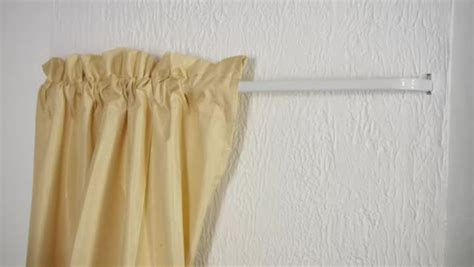 mounting curtain rods on plaster walls video how to screw a curtain rod through plaster ehow