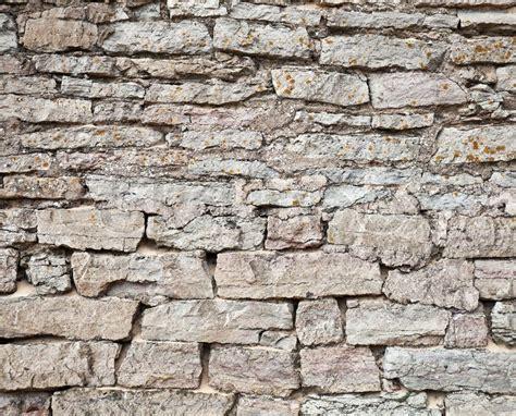 alte steinwand alten steinwand grauen detaillierte textur stockfoto
