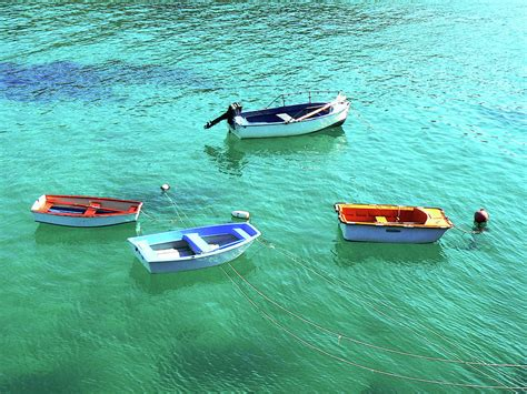 row boat on water row boats on turquoise water photograph by leniners
