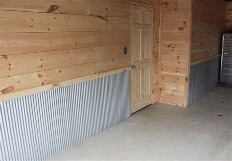 shiplap garage wall creating a finished garage on a shoestring budget