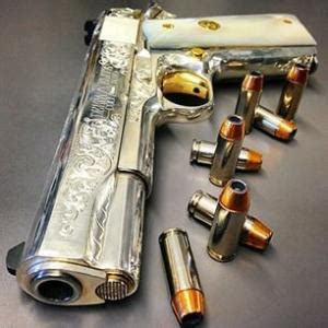 gorgeous engraved 1911 with gold accents and pearl grips