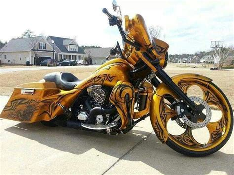 gold motorcycle custom gold bike with tribal graphics harleys