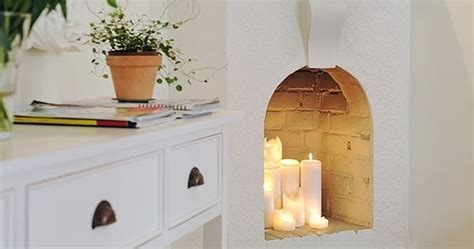 31 home decor hacks that are borderline genius light an array of candles in an unused fireplace 31