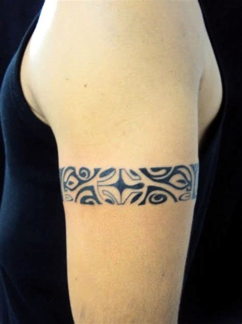 tribal arm band tattoo on biceps real photo pictures