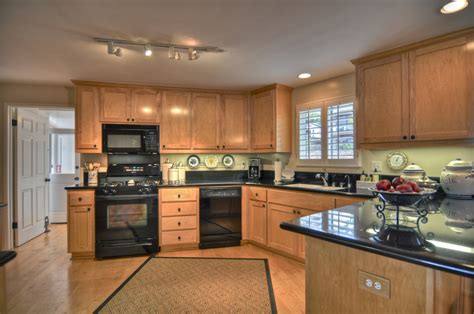 kitchen black appliances cozy corner beach cottage in laguna california for sale