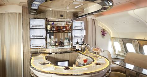 cabin classes emirates revs its spirits offering in all cabin classes