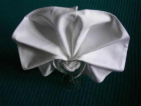 Folding Paper Napkins In Glasses - serviette napkin folding set into a wine glass recipe