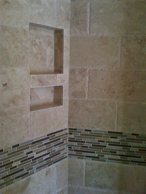 6x12 chiseled edge travertine field tile with stone glass and porcelain accent strip in master